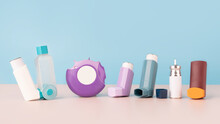 Set Of Asthma Inhalers For Asthma And COPD Patients On Table. Pharmaceutical Product Is Used To Treat Lung Inflammation And Prevent Asthma Attack Symptoms. Health Care And Medical Concept. Copy Space.