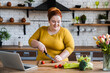 Leinwandbild Motiv Plus size , fat caucasian woman learning to make salad and healthy food from social media,Social distancing, stay at home concept
