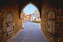 Idyllic German Cobbled Street. Tower Gate Passage And Street Architecture Of Medieval German Town Of Rothenburg Ob Der Tauber View. Bavaria Region Of Germany