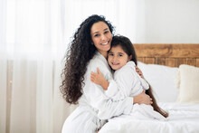 Cheerful Mother And Daughter Hugging In Bedroom, Copy Space