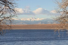 Chatfield Dam Between Lake And Mountains