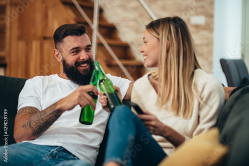 Fotografering Couple drinking beer at home