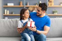 Loving Girl Celebrating Father's Day, Greeting Excited Dad With Present