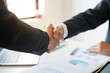 Businessman shaking hand after achieve agreement and deal their business to expand business investment network and building project development or employment business and agreement concept