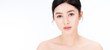 Closeup portrait of beauty asian woman with fair perfect healthy glow skin bare shoulder isolated copy space, young beautiful asia girl with pretty smile on face. Beauty korean clinic skincare banner