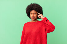 Afro Black Woman Feeling Confused And Puzzled, Showing You Are Insane, Crazy Or Out Of Your Mind