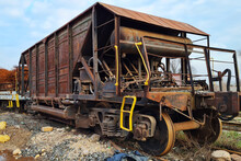 Abandoned Old Rusty Freight Industrial Wagon On A Factory Railroad At Sunny Day.