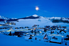 Moon Glow Mt. Crested Butte - Moon Glows Bright Above The Town Of Mt. Crested Butte And Mt. Emmons In Winter Snow, Gunnison County, Colorado