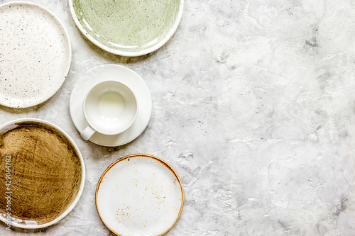 Tablou Canvas ceramic tableware top view on stone background mock up