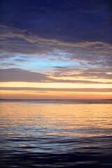 Sunset sea beach. Bright sunrise with yellow horizon under the sea surface.