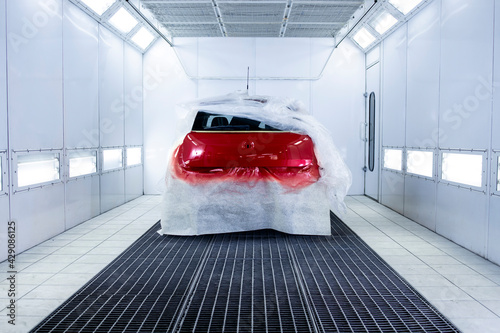 Fotografia, Obraz Freshly painted car drying in painting chamber.