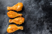 Spicy Smoked Chicken Leg Drumsticks On A Kitchen Table. Black Background. Top View. Copy Space