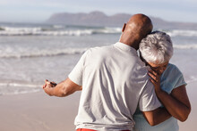 Close Up Of Senior African American Couple Dancing Together On The Beach