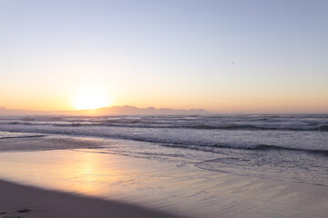 Beautiful view of landscape with beach sea and waves during sunset