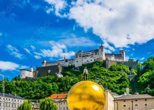 Carta da parati the festung Hohensalzburg fortress with the Sphaera sculpture situated on the Kapitelplatz in the central Salzburg, Austria