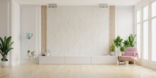 Cabinet For TV On The White Plaster Wall In Living Room With Armchair,minimal Design.