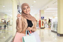 Muslim Woman Holding Shopping Bag On White