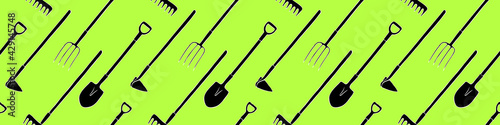 Fotografering Seamless pattern with garden equipments: shovels, spades, rakes, hoes, pitchforks