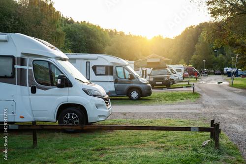 Camper vans in a camping park Fotobehang