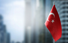 A Small Flag Of Turkey On The Background Of A Blurred Background