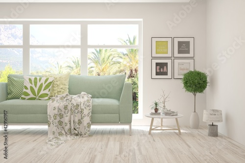 Fotografie, Obraz White living room with sofa and summer landscape in window