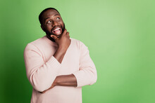 Photo Of Excited Clever Man Finger Chin Look Empty Space Wear White Shirt Over Green Background