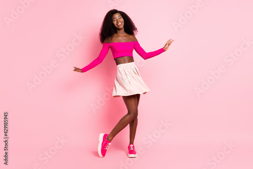 Fototapeta Photo of lovely young lady dance wear top uncovered shoulders short skirt footwe