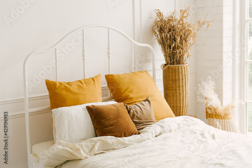 Beautiful light interior in Scandinavian style, white bed with window decoration - fototapety na wymiar