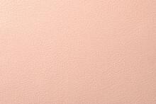 ピンク色のレザー調の質感のある紙の背景テクスチャー