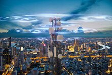 Telecommunication Tower With 5G Cellular Network Antenna Wave On Night City Background