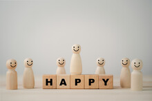 Smiley Face On Wooden Miniature Figure With Happy Wording On Wooden Cube For The Best Customer Evaluation And Satisfaction Product And Service.