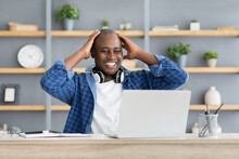 Business Success And Luck. Excited Black Businessman Looking At Laptop Computer And Touching Head In Excitement
