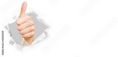 Weibliche Hand zeigt Daumen hoch als Erfolg Konzept - fototapety na wymiar