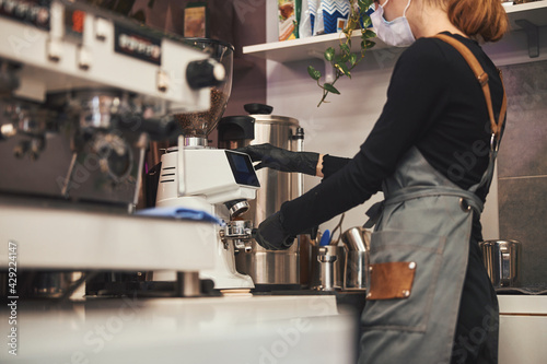 Hard-working barista preparing a good cup of coffee Fotobehang