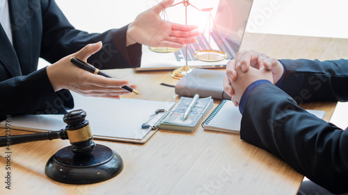 Fotografia A lawyer with a brass scale on a desk in an office Law legal services, justice a
