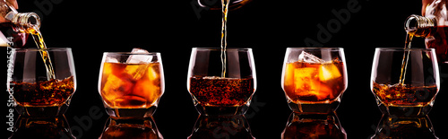 set of whiskey pouring in glasses with ice cubes isolated on black background. - fototapety na wymiar
