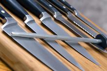 Kitchen Knives Set On Wood Cutting Board