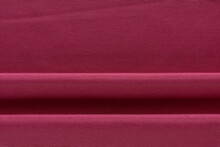 Thick Curtain Cotton Fabric Of Crimson Color, Folded In Folds, Background