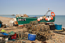 Fishing Boat Pulled Up On Shingle Beach With Lobster Pots, Deal, Kent, England, UK