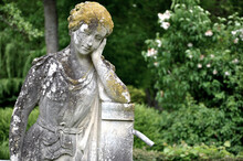 Statue Of A Woman Resting Her Face In Her Hand