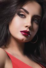 Beautiful Makeup Woman With Burgundy Lipstick And Bright Smoky Eyes Makeup. Closeup