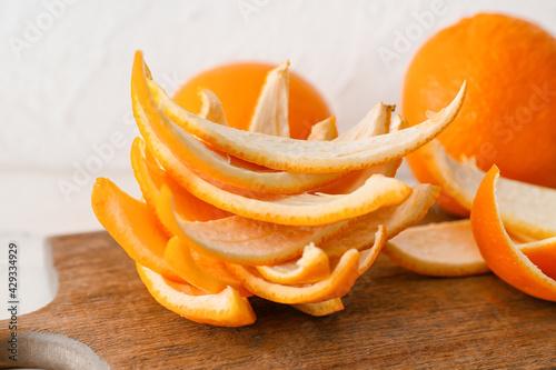 Board with fresh orange peel, closeup - fototapety na wymiar