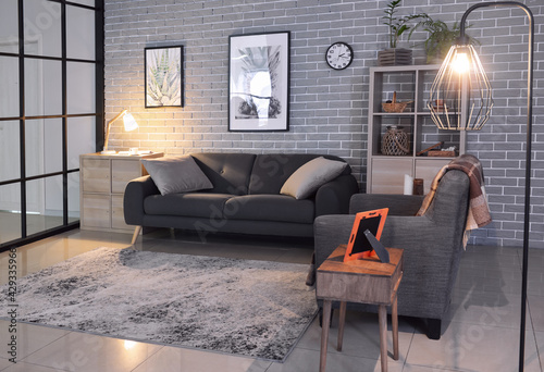 Obraz Interior of stylish living room with sofa and armchair - fototapety do salonu