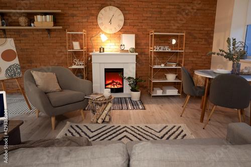 Interior of modern room with fireplace - fototapety na wymiar