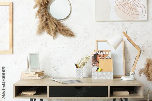 Obraz Stylish workplace in interior of room - fototapety do salonu