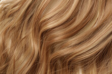 Closeup Texture Of Single Piece Elastic String Tied Wavy Auburn Mixed Blonde Highlights Synthetic Hair Extensions