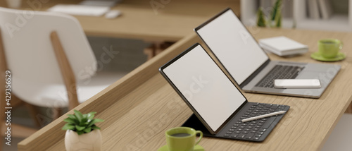Side view, 3D rendering, portable workspace with two laptops and supplies on wooden table, 3D Illustration