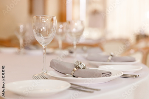 Fototapeta Festive Floral decor on wedding banquet tables in white colors with cutlery