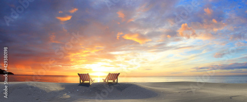 Chairs In sunset Beach. colorful twilight sky - fototapety na wymiar