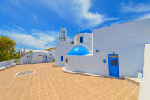 Greece Santorini Island In Cyclades, Traditional View Of White Washed Houses With Colorful Wooden Frames